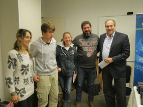 Rabbi Yechiel Eckstein (right) delivers a check to a newly arrived family of immigrants to Israel.