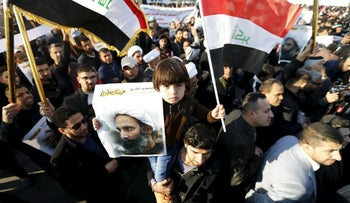 Supporters of Shi'ite cleric Moqtada al-Sadr protest against the execution of Shi'ite Muslim cleric Nimr al-Nimr in Saudi Arabia, during a demonstrations in Baghdad January 4, 2016.