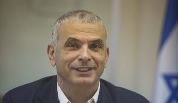 Israeli Finance Minister Moshe Kahlon briefing reporters at the Knesset on Monday.