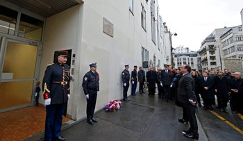 French President Francois Hollande attends ceremony at the former offices of Charlie Hebdo to pay tribute to the victims of the last year's January attacks in Paris, France, Jan. 5, 2016.
