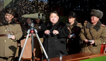 North Korean leader Kim Jong watches a firing contest of the KPA artillery units at undisclosed location in a photo released by North Korea's Korean Central News Agency in Pyongyang January 5, 2016.