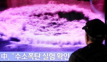 A man watches a television screen showing a news broadcast on North Korea's nuclear test at Seoul Station in Seoul, South Korea, on Wednesday, Jan. 6, 2015.