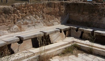 The Romans are credited with introducing toilets to European towns some 2,000 years ago, much like this marble public latrine in Lepcis Magna, Libya.