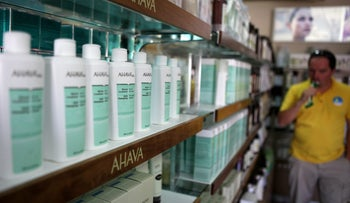 A file picture taken on July 12, 2011 showing a man looking at AHAVA Dead Sea cosmetic products manufactured in the Israeli Kibbutz settlement of Mitzpe Shalem in the Dead Sea resort of Kalya.