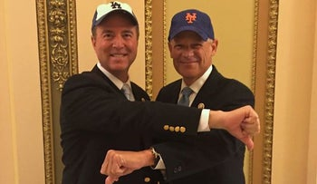 Reps. Adam Schiff, D-Calif, left, and Steve Israel, D-N.Y., display their distaste for the opposing side while announcing a bet on the outcome of the Mets-Dodgers National League Division Series, Oct. 1, 2015.