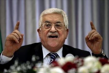 Palestinian President Mahmud Abbas gesturing as he speaks during a Christmas lunch with members of the Christian Orthodox community on January 6, 2016 in the West Bank city of Bethlehem.