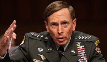 U.S. General David Petraeus gestures during the Senate Intelligence Committee hearing on his nomination to be director of the Central Intelligence Agency in this file photo taken June 23, 2011.