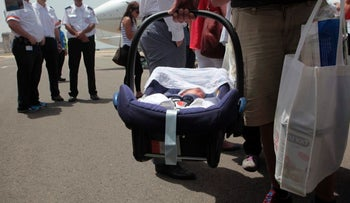 Surrogate babies being brought from Nepal to Israel, April 2015.