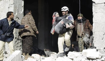 An injured woman being carried out of a site hit airstrikes, in the rebel-controlled area of Maaret al-Numan town in Idlib province, Syria, January 9, 2016.
