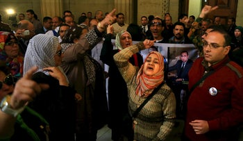 Supporters of former Egyptian President Hosni Mubarak shout slogans at the High Court after the verdict of Mubarak's trial, Cairo, Egypt, January 9, 2016.