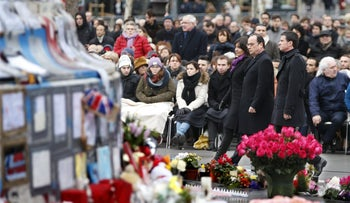 French President Francois Hollande, Prime Minister Manuel Valls and Paris Mayor Anne Hidalgo attend a ceremony at Place de la Republique square to pay tribute to the victims of last year's shooting at the French satirical newspaper Charlie Hebdo, Paris, France, January 10, 2016.