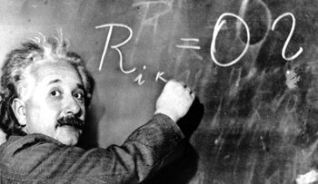 Albert Einstein writes out an equation for the density of the Milky Way on the blackboard at the Carnegie Institute in Pasadena, California, on January 14, 1931.