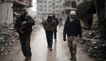 Fighters from the Jaysh al-Islam, the foremost rebel group in Damascus province who fiercely opposed to both the regime and ISIS, patrol the front line in Jobar, Syria, January 4, 2016.