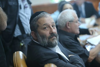 Arye Dery faces the camera during a meeting, October 2015.