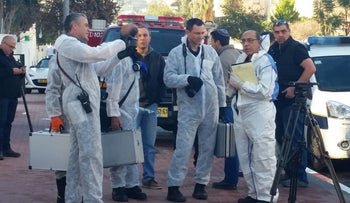 A forensic team outside the offices of the human rights organization B'Tselem in Jerusalem, January 11, 2016.
