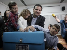Ayman Odeh, head of Joint Arab List, casts his ballot with his children at a polling station in Haifa on March 17, 2015.