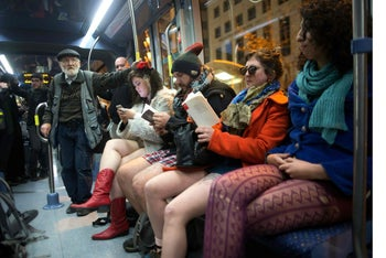 sraelis travel on a light rail without their pants on as they take part in the third annual 'No pants subway ride' event in Jerusalem January 10, 2016.
