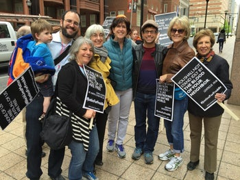 Congregants from Beth Am, with Rabbi Burg third from right, along with members of Jews United for Justice at a social justice demonstration in Baltimore.