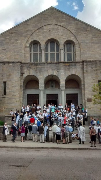 Members of the Beth Am congregation in Baltimore, praying outside following protests in the city.