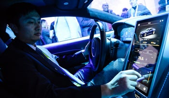 In-car display of the Letv ecosystem and connected car technologies in an Aston Martin Rapide S at the Consumer Electronics Show, Las Vegas, U.S., January 6, 2016.