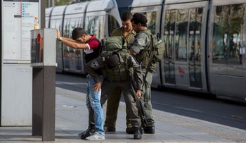 Israeli security forces frisk a man in Jerusalem, October 2015.