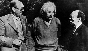 The German physicist Albert Einstein, center, talking to the Yiddish poet Itzik Fefer, left, and the Russian actor Solomon Mikhoels, who would be murdered by Stalin's secret police