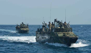 A file photo of the Costal Riverine Squadron 2 escorting the USS Bunker Hill while in the Arabian Gulf, June 27, 2013.