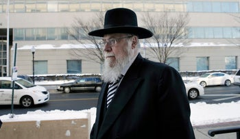 Rabbi Mendel Epstein, arrives for his trial, he was convicted in April 2015 of conspiracy to commit kidnapping.