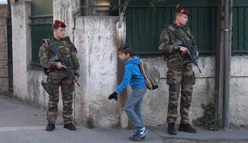 French soldiers guard a Jewish school in Marseille, January 12, 2016.