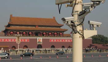 Security cameras look out over Tiananmen Square: Beijing would be thrilled for Chinese subjects to think outside the box - when it comes to inventing technology. But when they get home at night, keep your opinions to yourself.