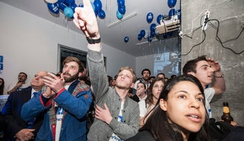 V15 activists, with Itamar Weizmann (C), watch as the election results are announced, March 17, 2015.
