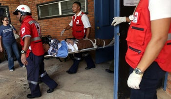 An unidentified person is carried into the Valle de Angeles Adventist Hospital after being involved in a bus accident near Tegucigalpa, Honduras, January 13, 2016.
