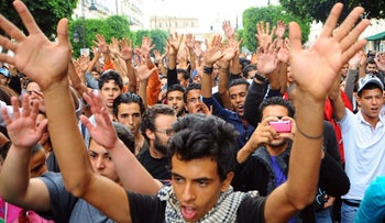 Anti-government demonstrators raising their hands during a protest in Tunis, 2012.