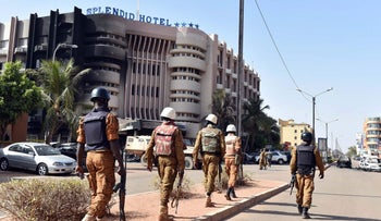 Burkina Faso's troops patrol outside the Splendid Hotel and nearby Cappuccino restaurant following a jihadist attack in Ouagadougou on January 16, 2016.