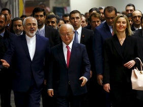 Iranian Foreign Minister Javad Zarif, IAEA Director General Yukiya Amano and EU foreign policy chief Federica Mogherini arrive at the UN building in Vienna, Austria, January 16, 2016.