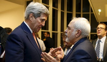 U.S. Secretary of State John Kerry talks with Iranian Foreign Minister Javad Zarif after the IAEA verified that Iran has met all conditions under the nuclear deal, in Vienna, January 16, 2016.
