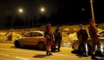 IDF guard near the Jewish West Bank settlement of Otniel on Jan. 17, 2016, after a woman was killed in her home by a Palestinian assailant.