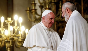 Pope Francis greets chief Rabbi Riccardo Di Segni during his visit to Rome's Great Synagogue, Italy, January 17, 2016.