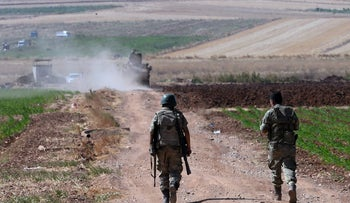 Turkish soldiers patrol near the border with Syria, outside the village of Elbeyli, east of the town of Kilis, Turkey, July 24, 2015.