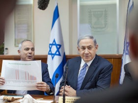 Minister Yuval Steinitz, left, with Prime Minister Benjamin Netanyahu. Steinitz and the Energy Ministry people looked only at the development of the gas fields, and didn't even think about how to convert Israel to gas.