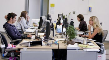 Young employees working at a high-tech company.