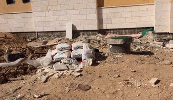 Waste is strewn across the courtyard of a Bedouin high school in the Negev.