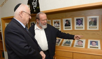 Israeli President Reuven Rivlin, left, with Rabbi Eli Sadan, during a 2014 visit to the settlement of Eli in the West Bank, where Sadan founded a pre-military preparatory program.