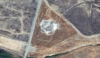 Two satellite images provided by DigitalGlobe, taken on March 31, 2011, top, and September 28, 2014, show the site of the 1,400-year-old Christian monastery known as St. Elijah's on the outskirts of Mosul, Iraq.
