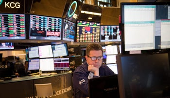 A trader works on the floor of the New York Stock Exchange (NYSE) in New York, U.S., January 20, 2016.