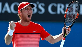 Dudi Sela of Israel celebrates after defeating Fernando Verdasco of Spain in their second round match at the Australian Open tennis championships, Melbourne, Australia, January 21, 2016.