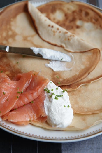 Crepes with sour cream and lox.
