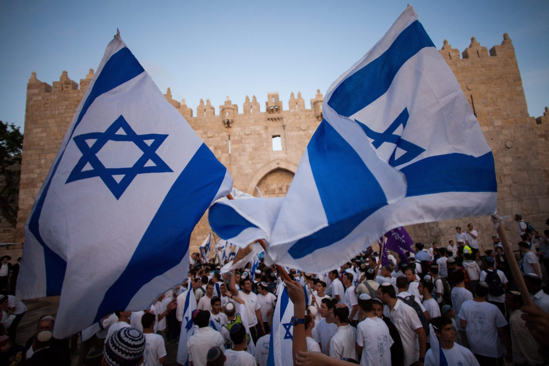Jews wave Israeli flags outside the Old City's Damascus Gate as they partake in the so-called 'march of the flags' to celebrate Jerusalem Day in 2012.