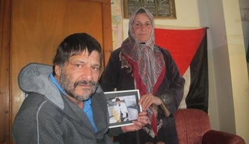 Mohammad Saba'neh's parents with a picture of their son.