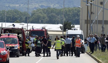 French police secure entrance of Air Products company in Saint-Quentin-Fallavier, France, after alleged ISIS attack. June 26, 2015.